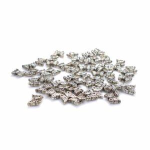 Perle papillon en métal 11 mm 4 pièces
