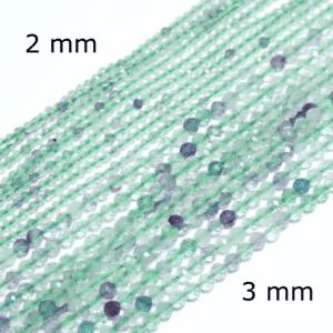Regenbogenfluorit Kugel facettiert 2 – 10 mm, 1 Strang