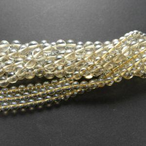 Bergkristall Kugel glanz gelb 4 – 12 mm, 1 Strang
