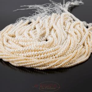 Freshwater pearls rondelle cream white 5 – 8mm, 1 strand