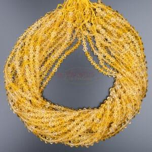Citrine toupie facettée jaune d'or environ 6x6mm, 1 fil